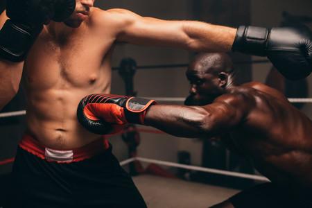 Nimble black athlete strikes his challenger