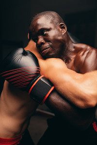 Two male athletes with boxing gloves