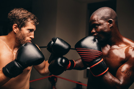 Two determined male boxers facing off