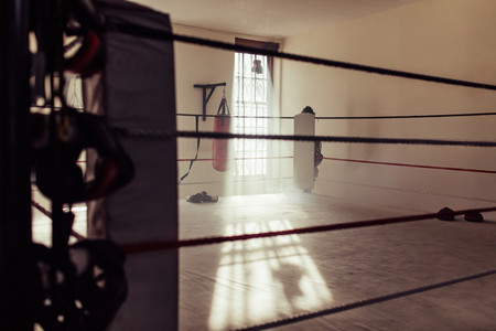 Empty boxing ring as seen from one corner