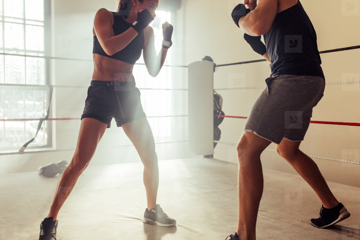 Male and female fighters raise their fists