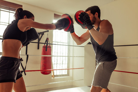 Woman in black shorts throws punch