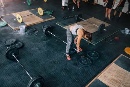 People exercising in crossfit gym
