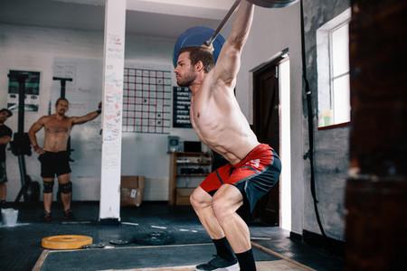 Bodybuilder doing cross training with barbell