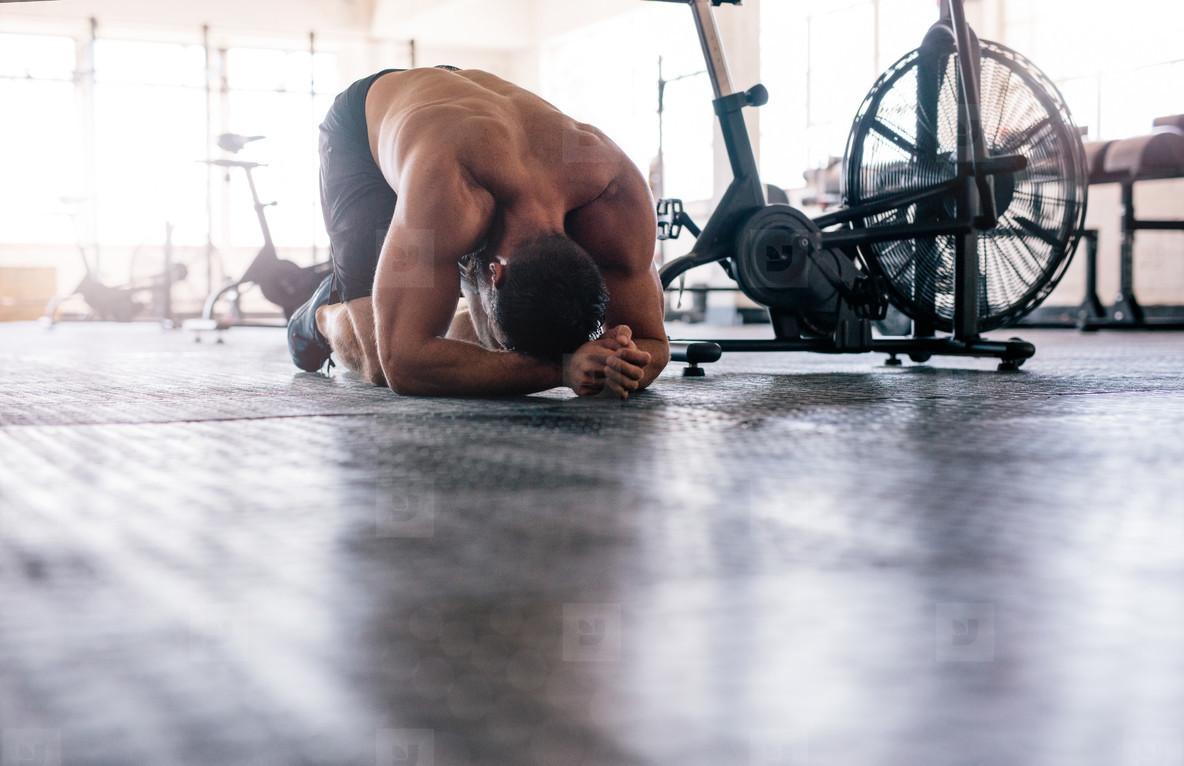 Muscular man taking break after crossing training
