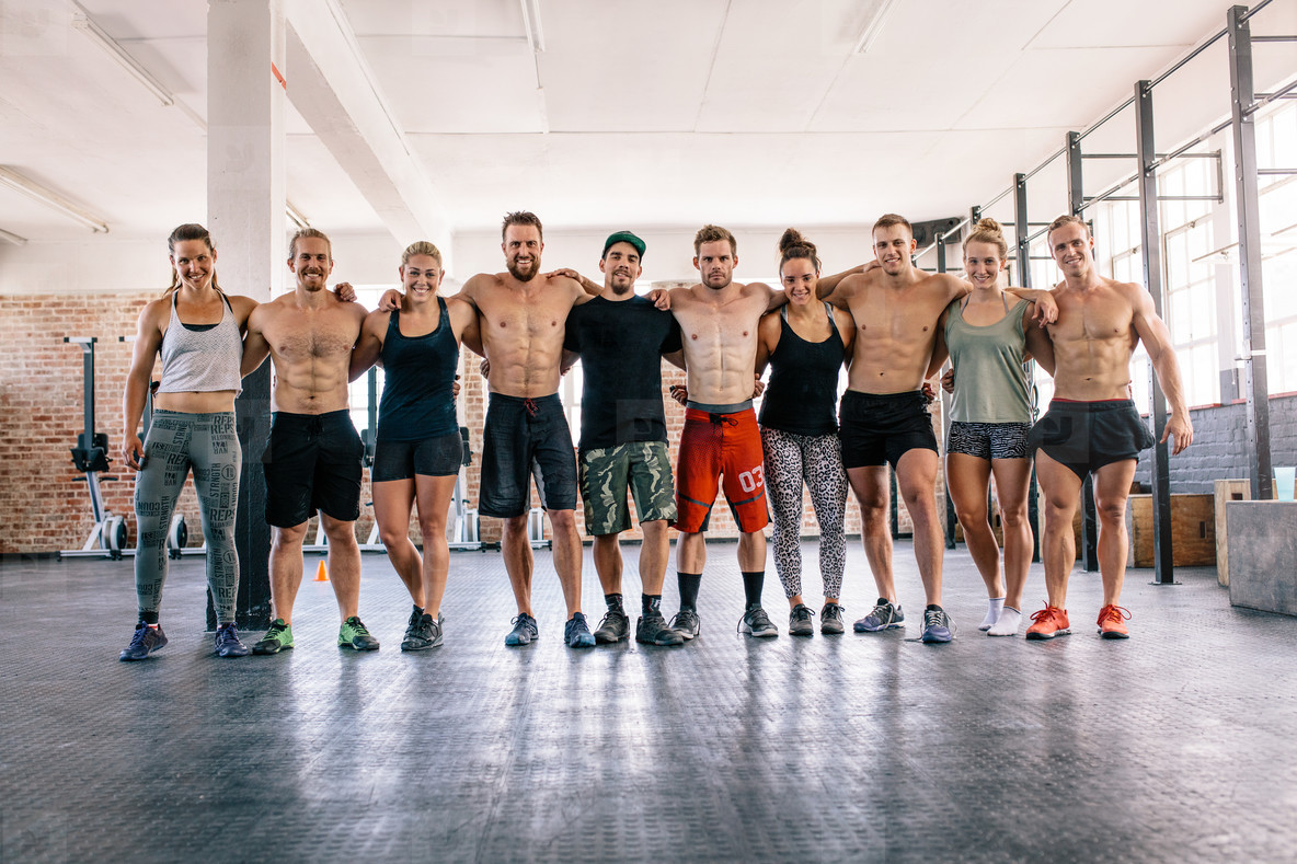 Large group of bodybuilders in crossfit gym