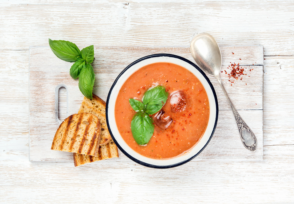 Cold gazpacho tomato soup in bowl with toasted bread