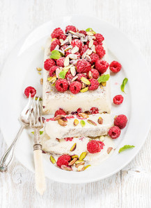 Homemade semifreddo with pistachio  raspberries and mint leaves