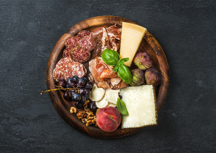 Italian antipasti snacks variety for wine on wooden tray