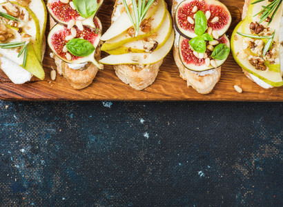Crostini with pear  ricotta cheese  figs  nuts and fresh herbs