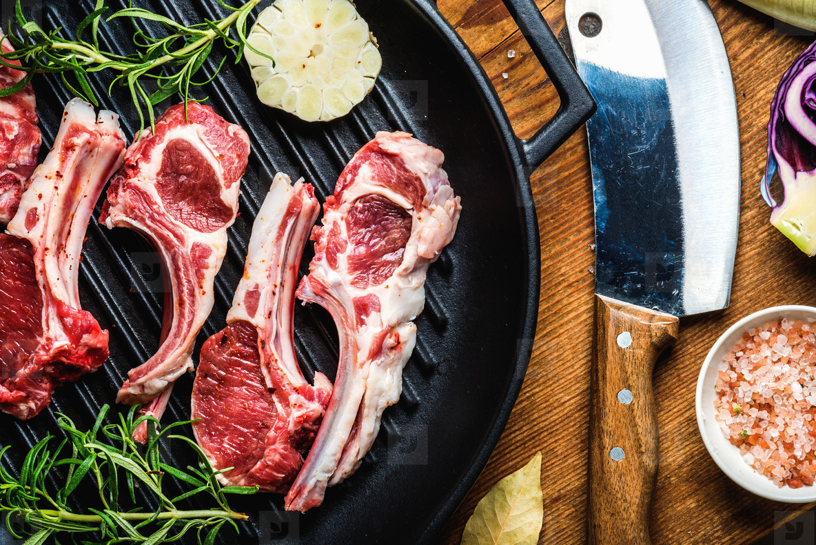 Raw uncooked lamb meat ribs with rosemary  garlic and salt