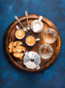 Coffee espresso  cantucci  cookies and milk on wooden serving board