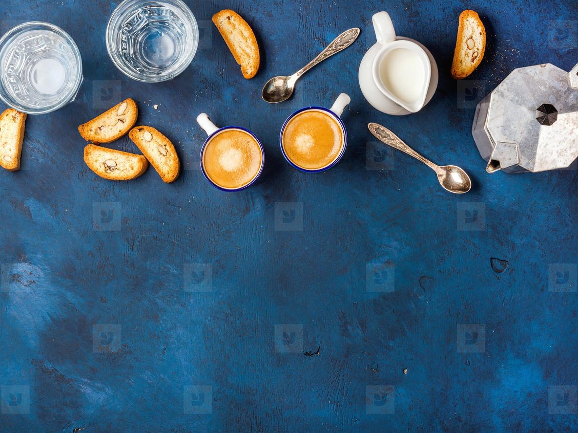 Coffee espresso  cookies and milk over dark blue background  vertical