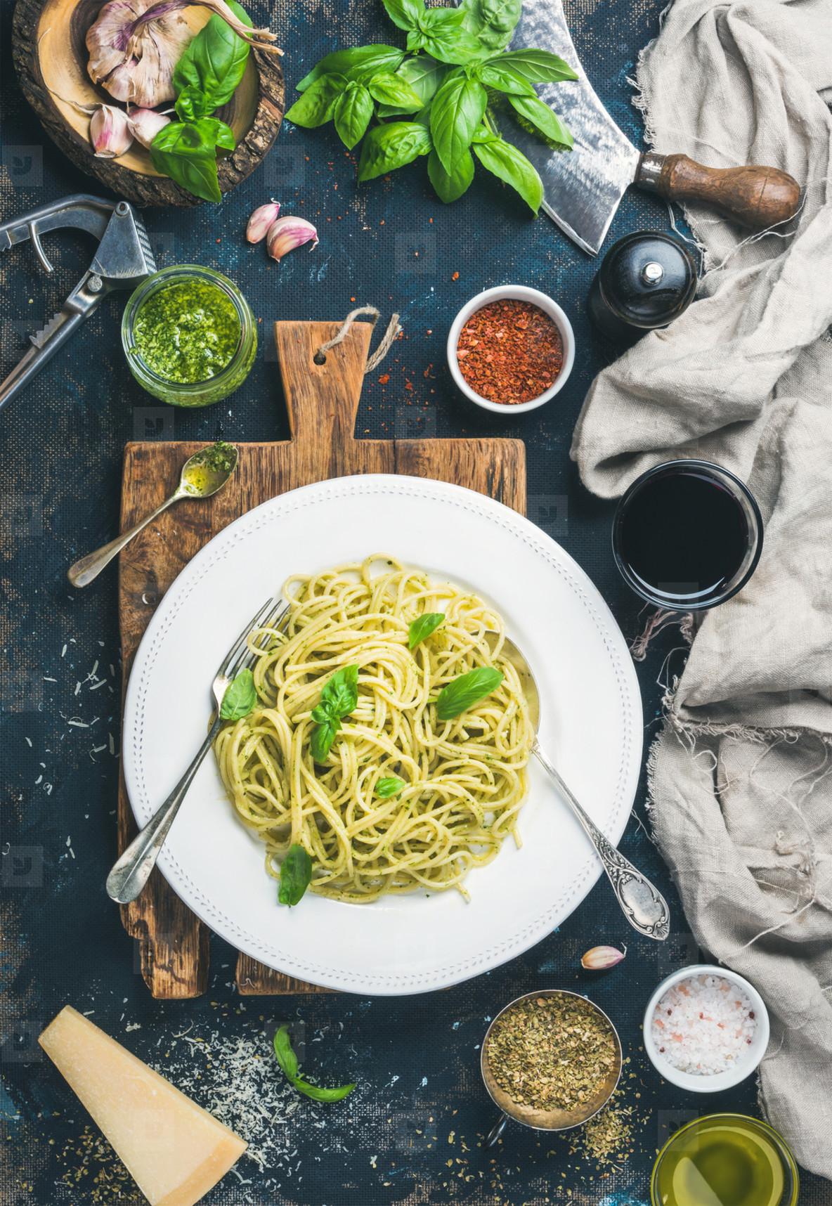 Spaghetti with pesto sauce  parmesan cheese  basil and wine