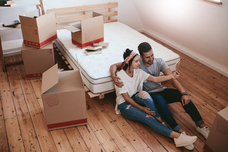 Young couple moving in new house and taking selfie