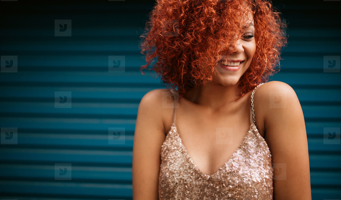 Happy young woman in glamorous dress