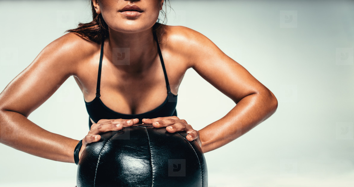 Young woman exercising with medicine ball