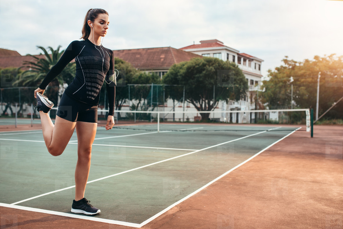 Sportswoman stretching leg outdoors