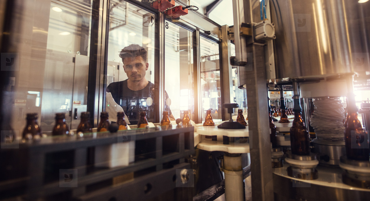 Brewer supervising the beer bottling process