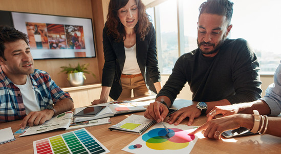 Group of creative designers discuss the color palette