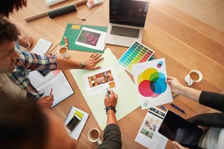 Creative designers discuss the color for new project