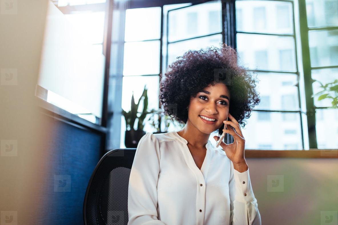 Female executive making a phone call