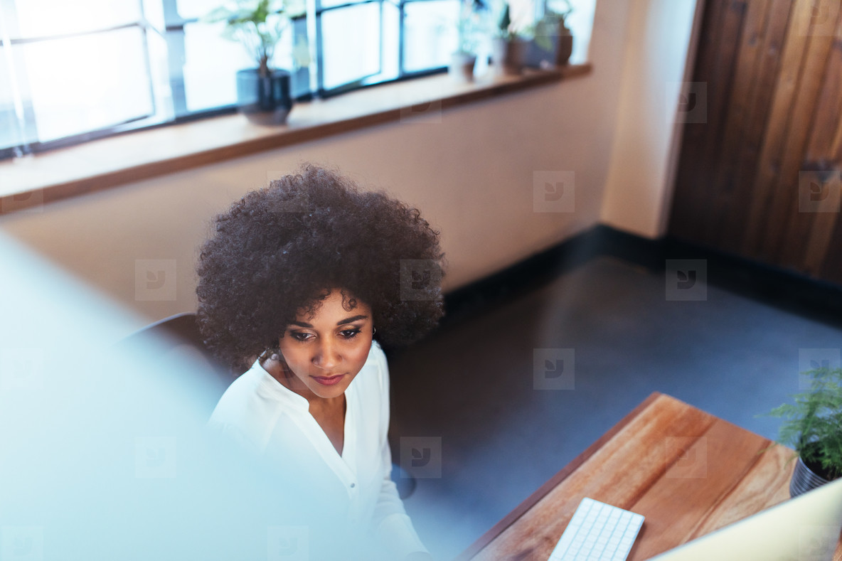 Young woman working at her office desk