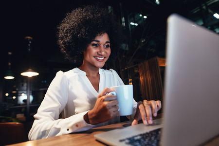 Young businesswoman working on the laptop at late night