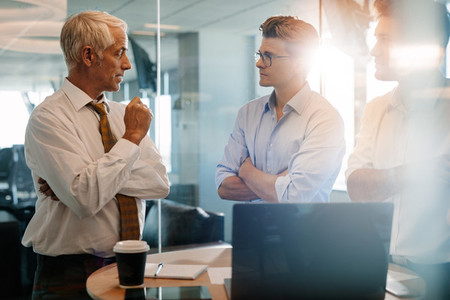 Senior boss giving business instructions to coworkers