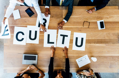 Business people discussing over work culture in office