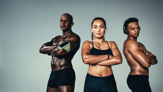 Group of muscular people with earphones