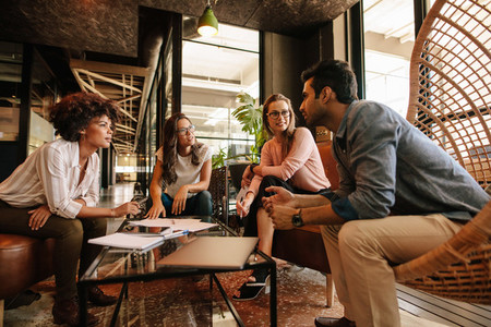 Creative people having a meeting in modern office