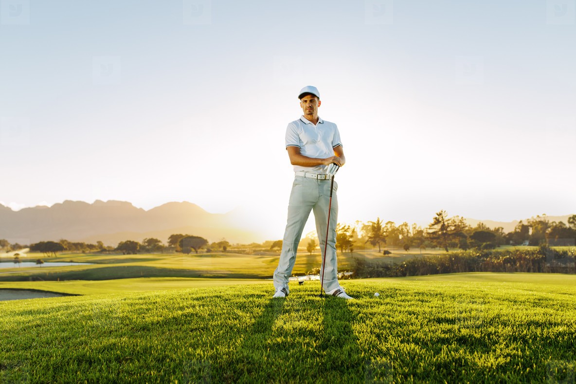 Male golfer standing on golf course
