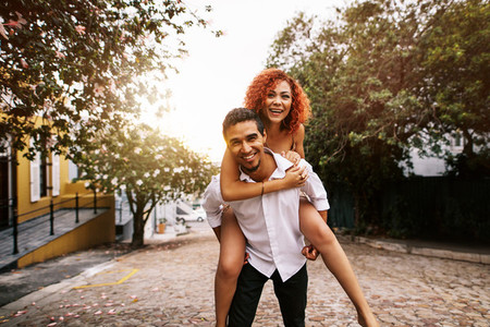 Young couple having fun in the street on a sunny day