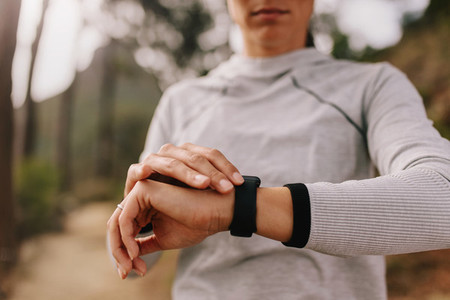 Runner checking fitness progress on her smart watch