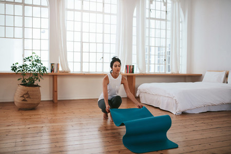 Fitness woman about to start yoga at home