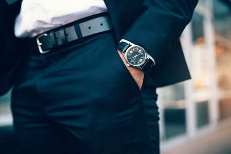 Business man039s hand in pocket wearing a watch