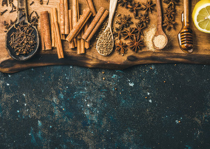 Ingredients for making gluhwein on wooden rustic board  copy space