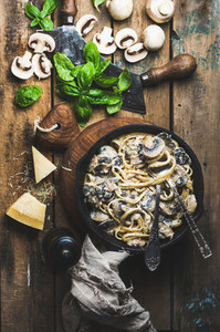 Mushroom pasta spaghetti in iron pan served with parmesan  basil