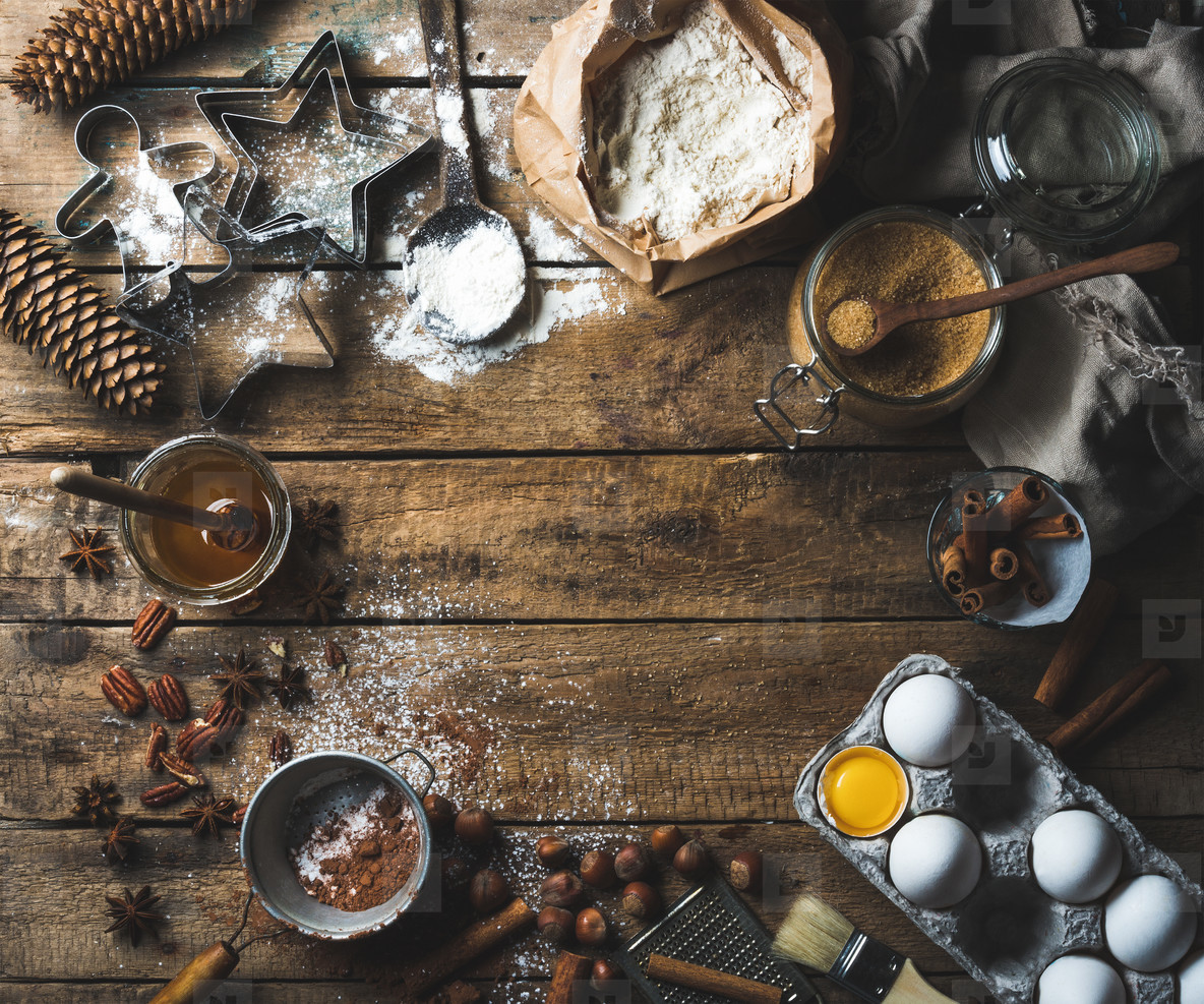 Christmas holiday cooking and baking ingredients on wooden background