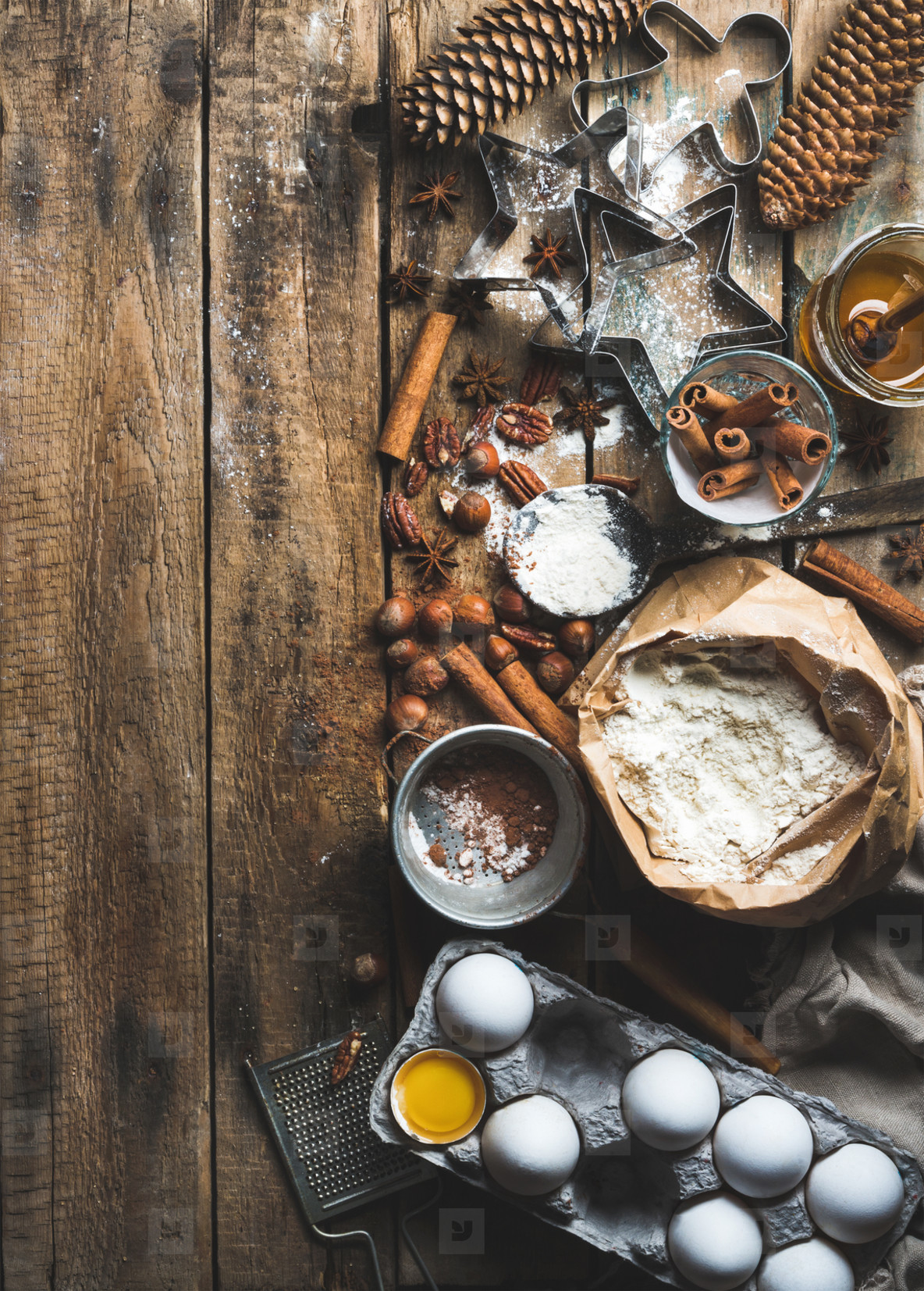 Christmas holiday cooking and baking ingredients on rustic wooden background