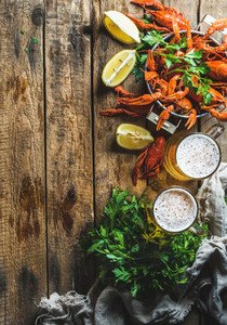 Wheat beer and boiled crayfish over old wooden rustic background