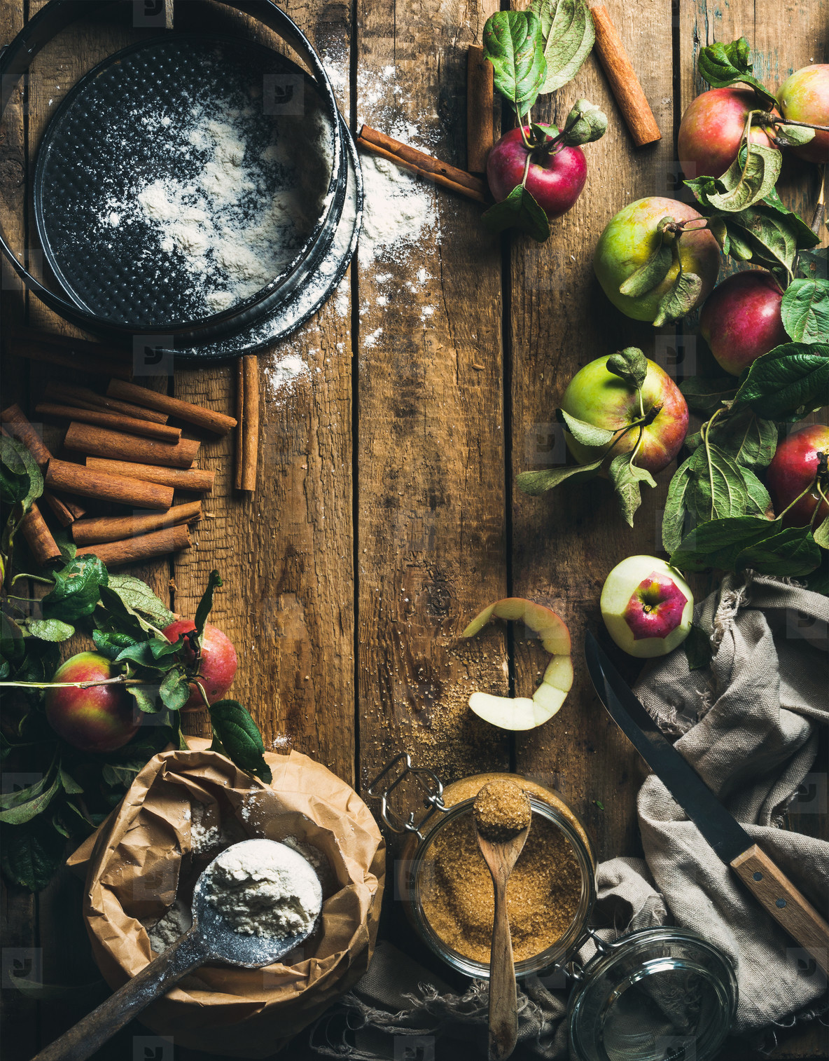 Ingredients for cooking apple pie over rustic wooden background