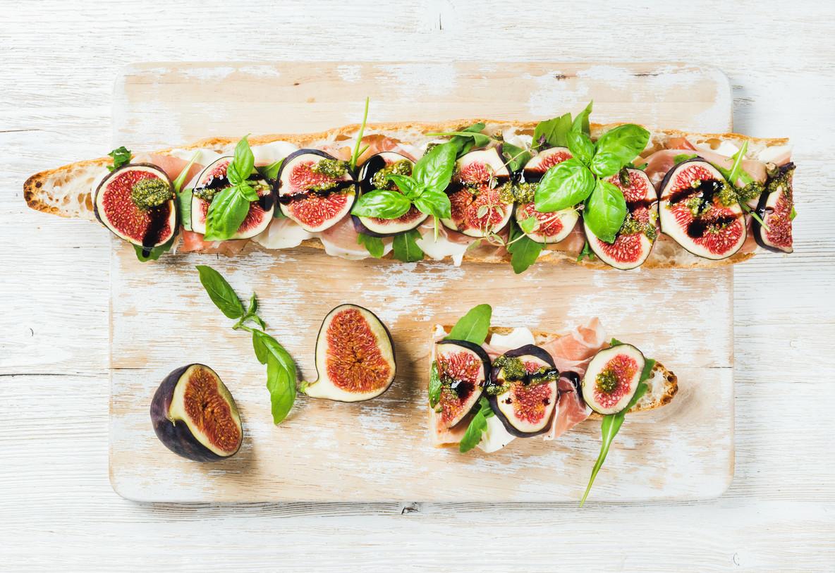 Long baguette sandwich with prosciutto  mozzarella  arugula  figs and basil