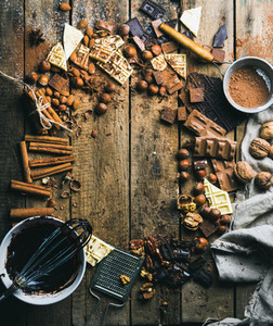 Hot chocolate cooking ingredients over rustic wooden background  copy space