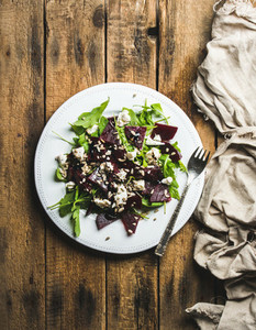 Arugula  beetroot  feta cheese and sunflower seed salad in plate