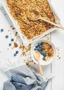Oat granola with pecan nuts yogurt and blueberry in bowl