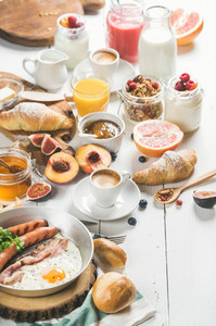 Breakfast snacks and drinks set on white wooden background