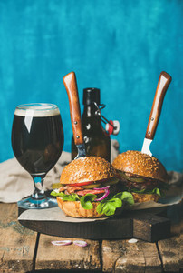 Beef burgers with crispy bacon vegetables and dark beer
