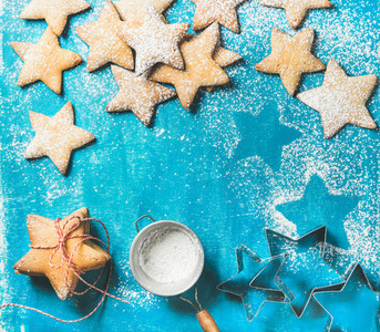 Christmas gingerbread cookies with sugar powder and metal shapes